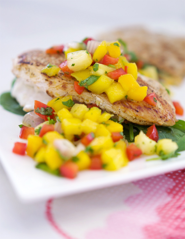 Colourful mango salsa tops seared chicken with tangy lime and savoury garlic
