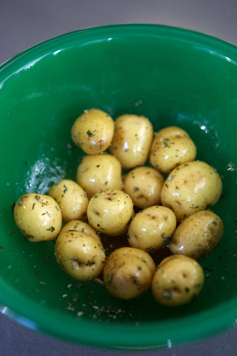 Seasoned potatoes in a green bowl