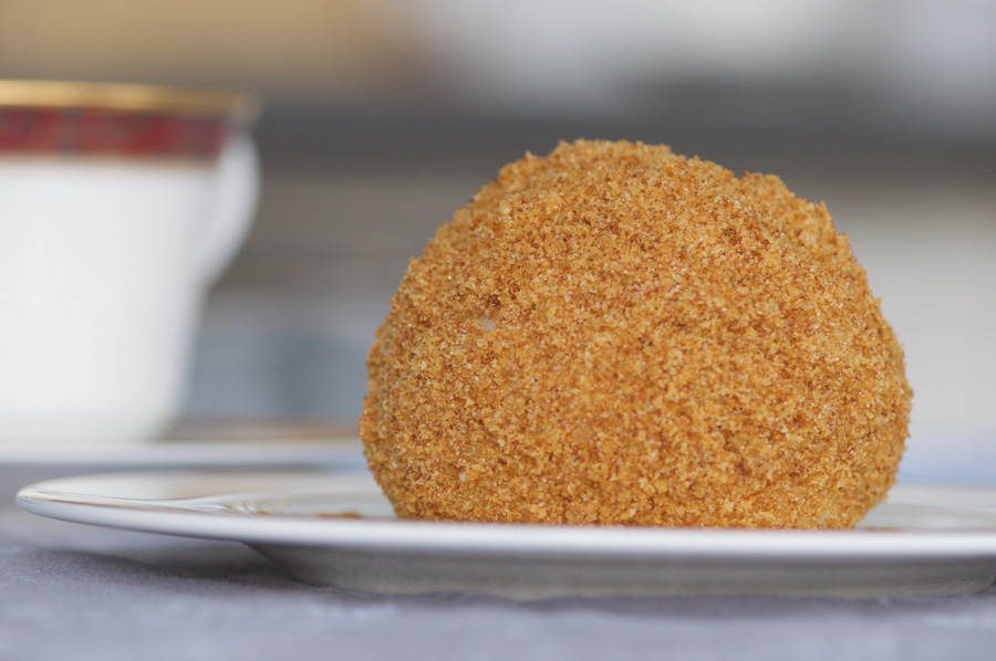 The finished dumpling with a golden breadcrumb crust