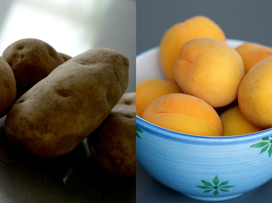dark earthy potatoes alongside brilliant apricots in a blue bowl