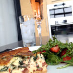 Quiche with rose bubbly and side salad