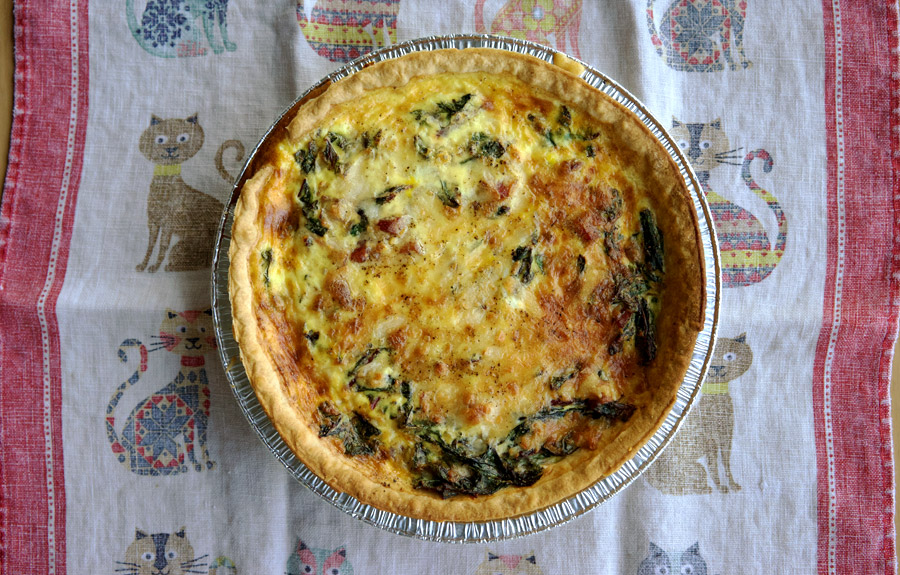 Quiche shot from above on linens
