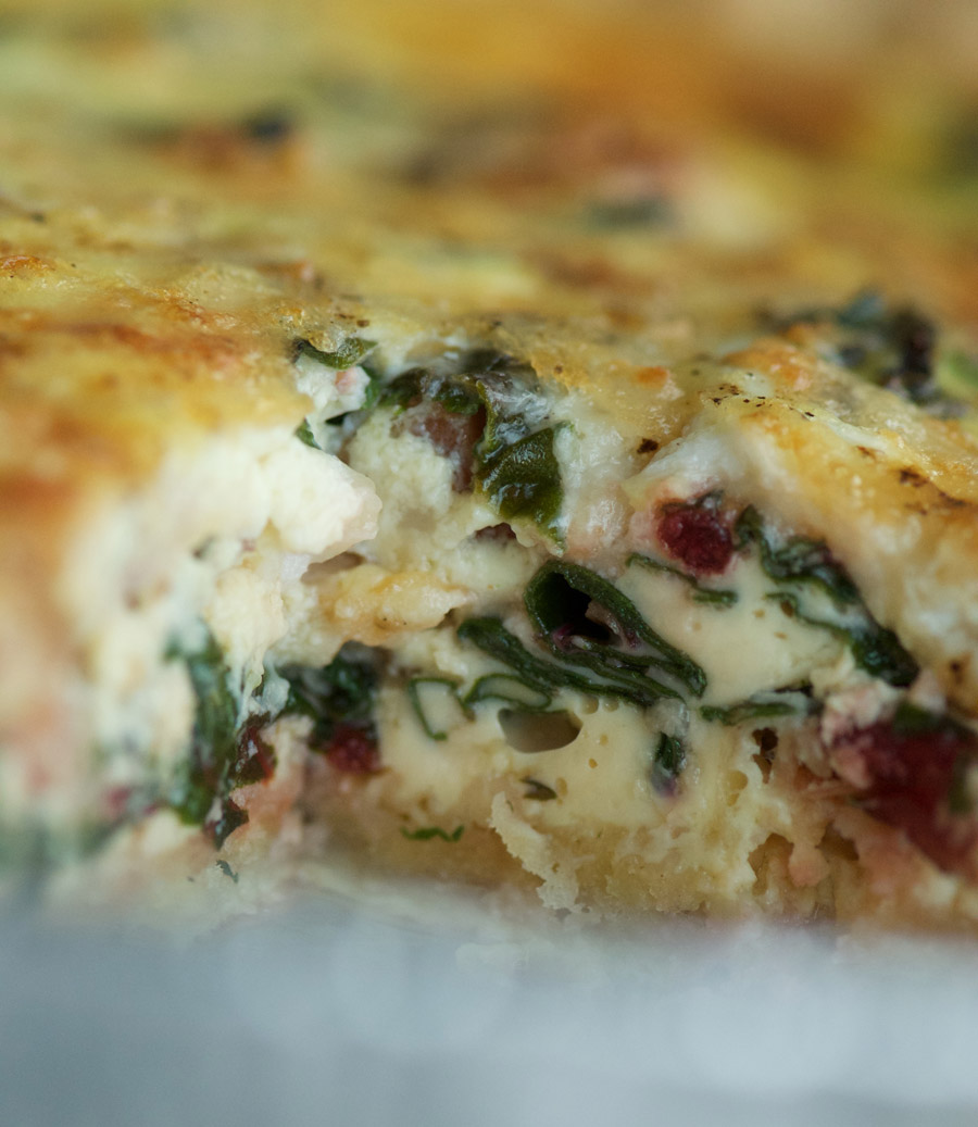 Super close up of the baked quiche filling