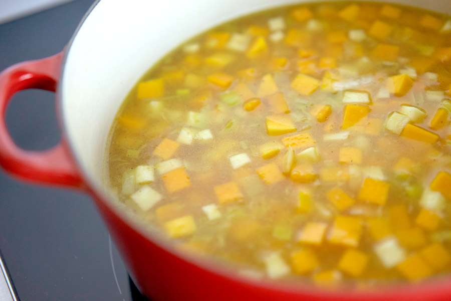 Chicken stock simmers with the vegetables