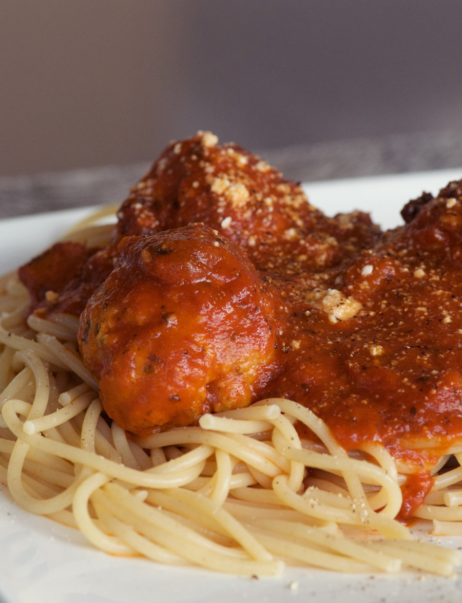 Parmesan Turkey Meatballs piled high onto spaghetti noodles with tomato sauce