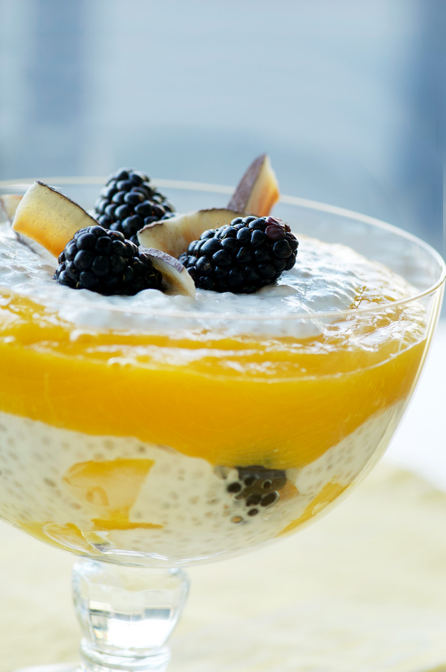 Berries, chia seed pudding and mango are layered into a healthy breakfast