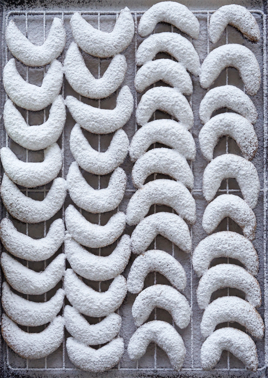 Vanilla Kipferl on a cooling rack dusted with vanilla sugar