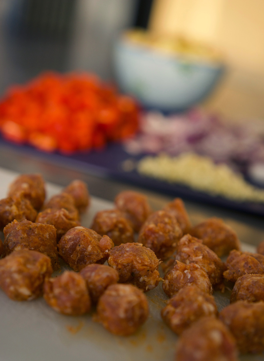 Remove italian sausage casings and cut into meatballs