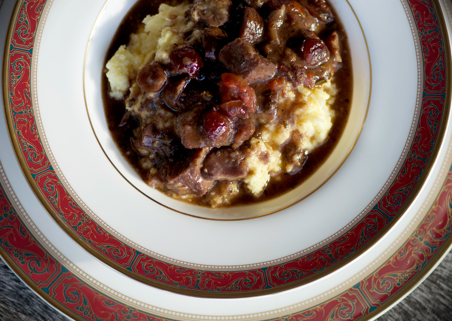 Lamb chestnut stew with mushrooms over polenta