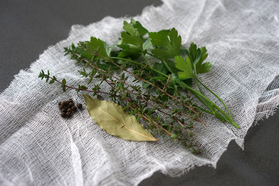 Prep a bundle of herbs in cheesecloth to flavour broth