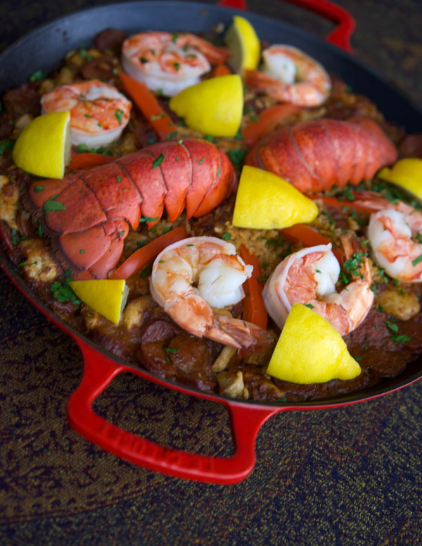 Paella with lobster, chicken and shrimp