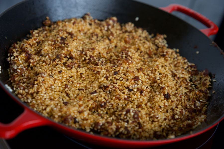 Bomba rice is toasted in the paella pan before adding the liquid