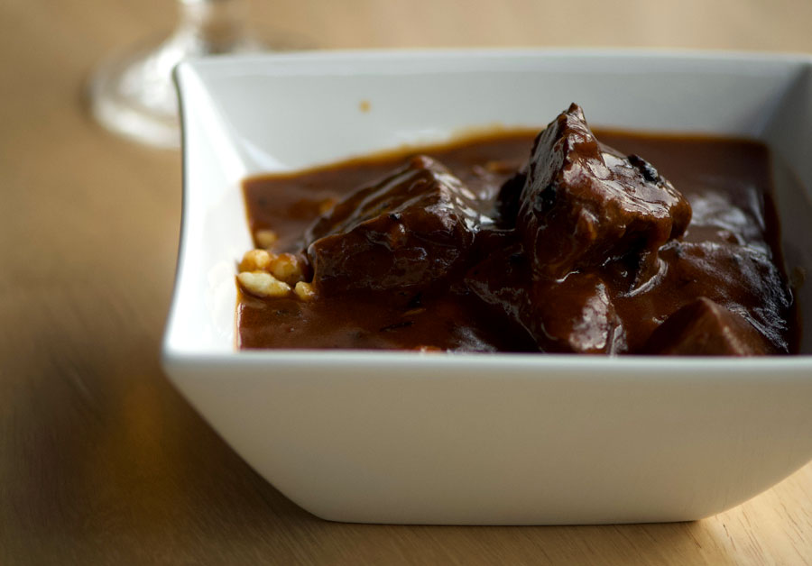 A hearty bowl of beef goulash is ready to eat.